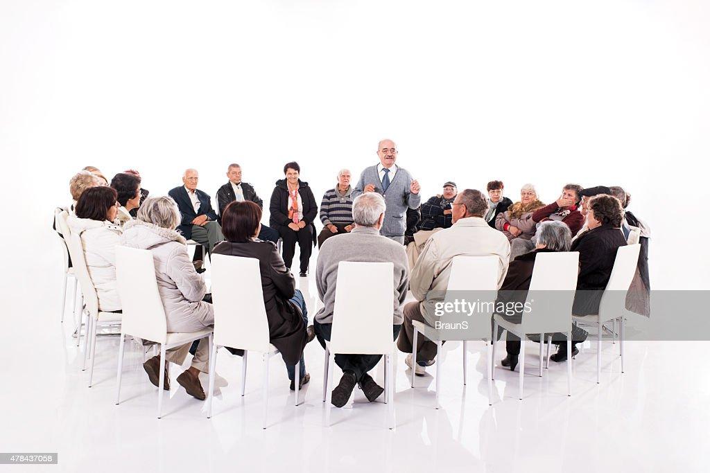 Large group of elderly people having a seminar. : Stock Photo