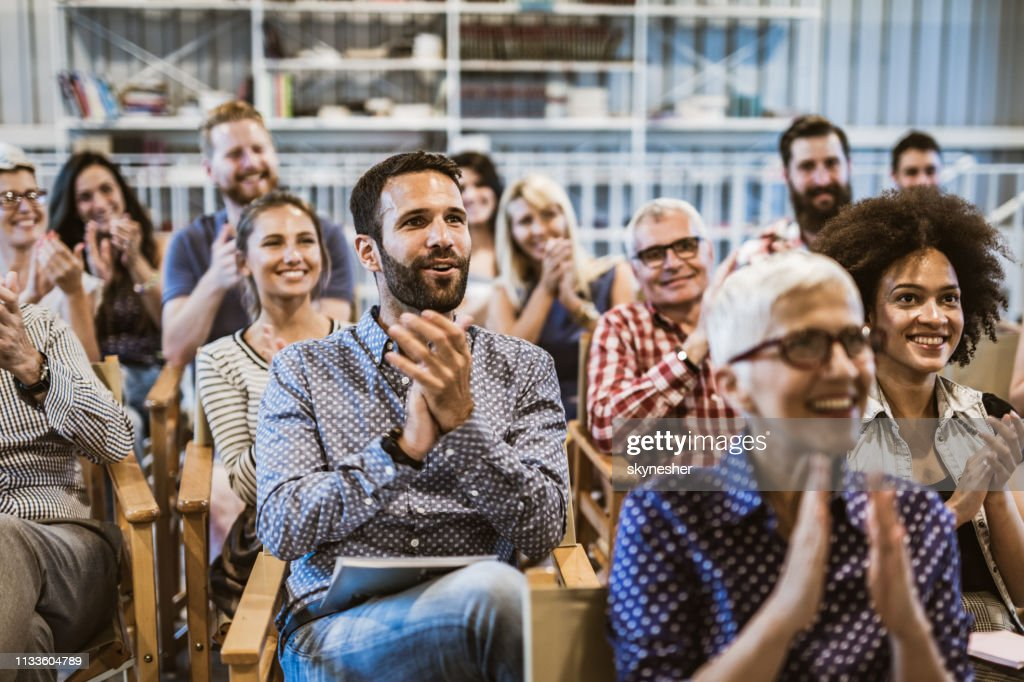 Large group of entrepreneurs applauding their colleague after seminar in board room. : Stock Photo