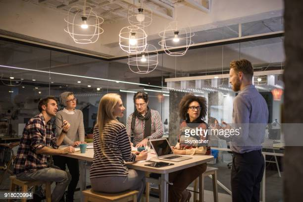 large group of entrepreneurs having a constructive meeting in the office. - business strategy stock pictures, royalty-free photos & images
