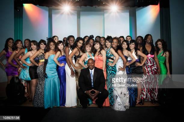 Large group of fashion models posing