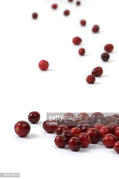 Large group of fresh cranberries on white background