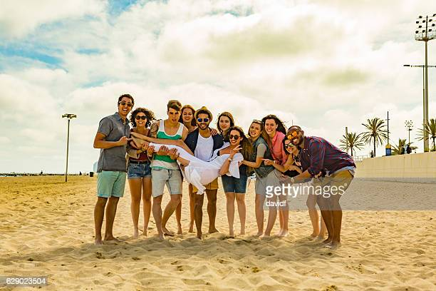 Large Group of Friends Having Fun on A Beach