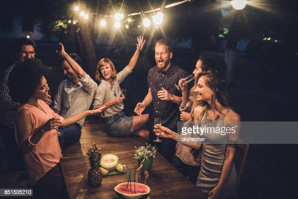 large group of friends having fun while dancing and singing on a night party. - adults only stock pictures, royalty-free photos & images