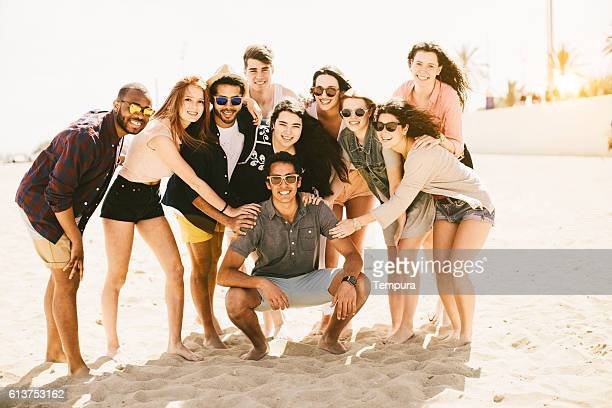 Large group of friends portrait at the beach