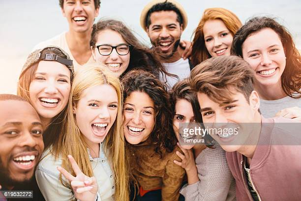 large group of friends portrait at the beach - group of objects stock pictures, royalty-free photos & images