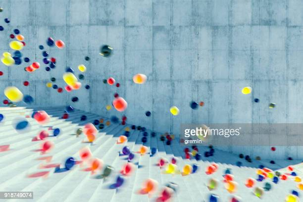 large group of glowing spheres falling down the urban concrete stairs - bouncing ball stock photos and pictures