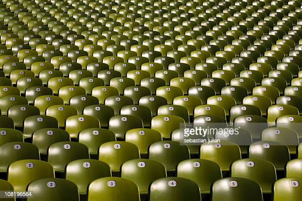 large group of green plastic seats in symetric rows - olympiastadion munich stock pictures, royalty-free photos & images