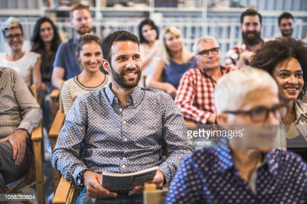 large group of happy business people attending a seminar. - attending stock pictures, royalty-free photos & images