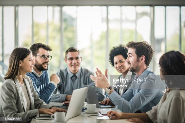 large group of happy business people having a discussion on a meeting in the office. - riunione commerciale foto e immagini stock