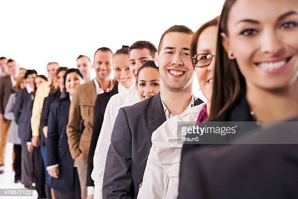 large group of happy business people in a row. - people in a line stock pictures, royalty-free photos & images