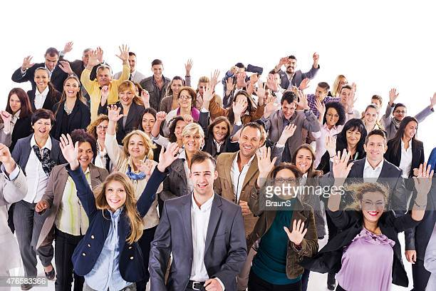 Large group of happy business people running together.