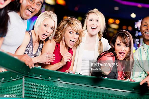 large group of happy diverse people at the craps table - alina stock pictures, royalty-free photos & images