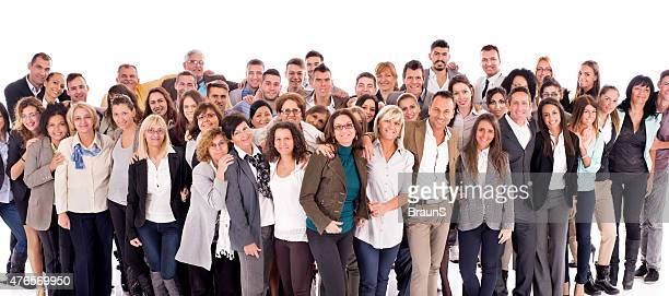 Large group of happy embraced business people isolated on white.