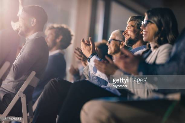 large group of happy entrepreneurs applauding on a seminar in board room. - applauding stock pictures, royalty-free photos & images