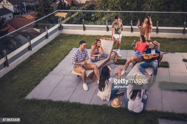 large group of happy friends having fun at a penthouse party. - women of penthouse stock photos and pictures