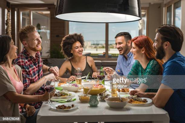 large group of happy friends having fun while talking on a dinner party. - dinner party stock pictures, royalty-free photos & images