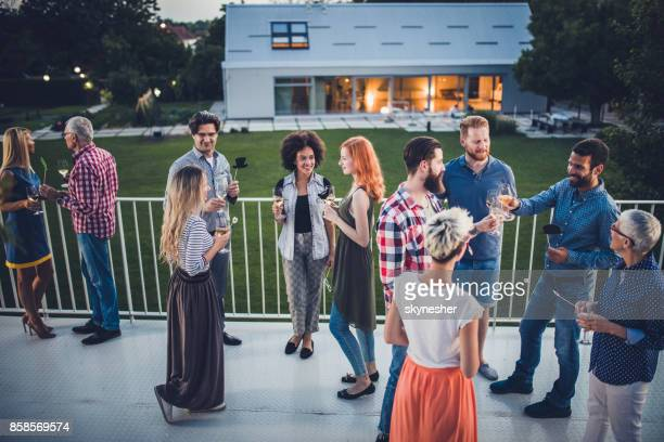 large group of happy people talking at outdoor party. - outdoor party imagens e fotografias de stock