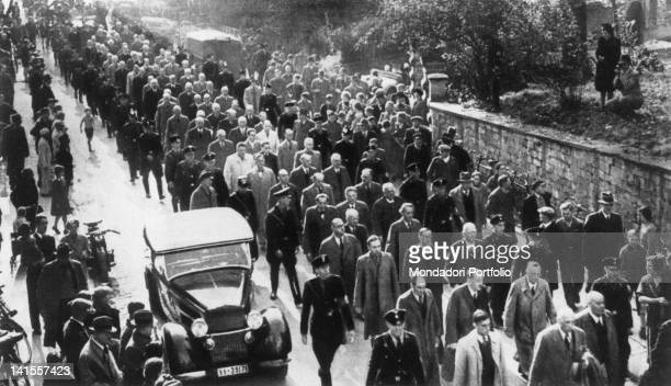 Large group of Jews, escorted by soldiers of the SS, are taken to a concentration camp before the eyes of the crowd at the roadside. Berlin, 1934