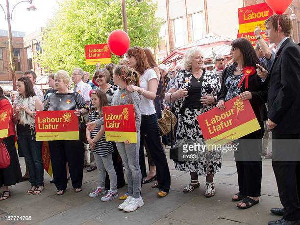 large group of labour party supporters at an election rally - labour stock photos and pictures