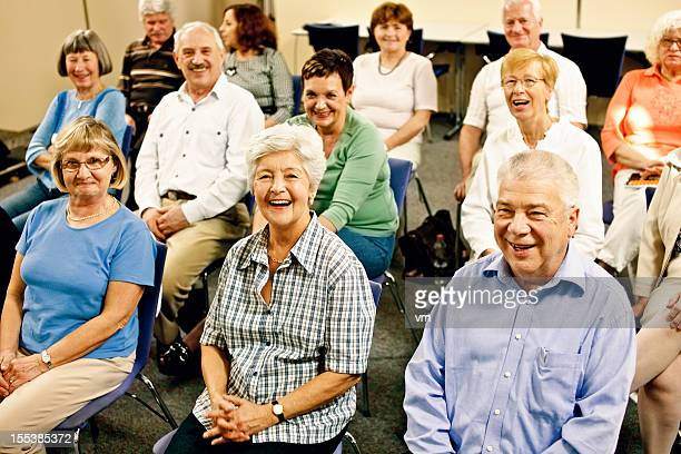 large group of laughing seniors - community center stock pictures, royalty-free photos & images