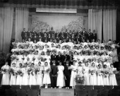 Large group of male and female graduates at the prom in formal wear picture id469494341?s=170x170
