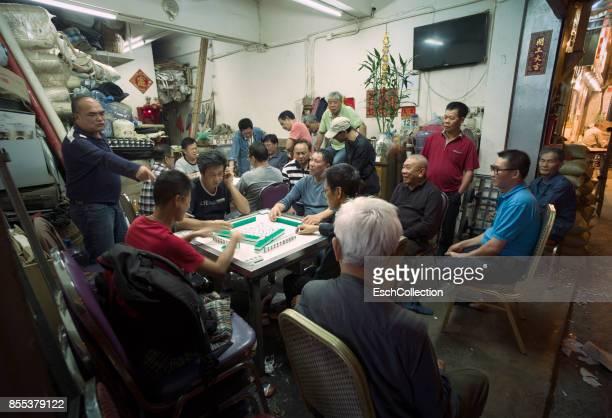 Large group of men playing Mahjong in Mong Kok, Hong Kong