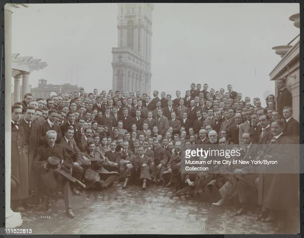 Large group of men posed at a fraternity convention of Alpha Delta Phi atop the Hotel Astor with Times Building in background New York New York April...
