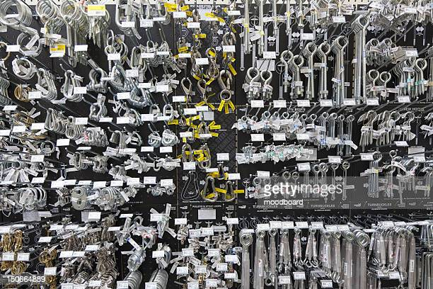 Large group of metallic equipments on display in hardware store