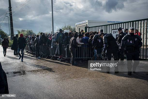 A large group of minors queuing in order to do an interview to meep up with a member of their famil who live in the UK Calais France on 22 October...