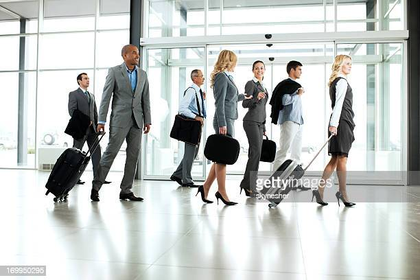 Large group of multiethnic business people walking at corridor