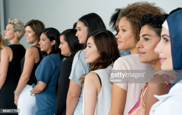 large group of multi-ethnic women smiling - women stock pictures, royalty-free photos & images