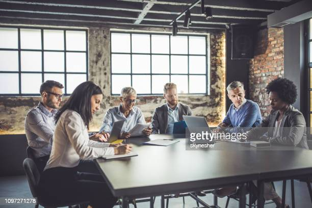 large group of multi-tasking business people working in the office. - businesswear stock pictures, royalty-free photos & images
