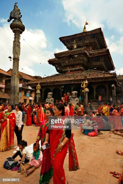 large group of nepalese women in traditional clothing at temple