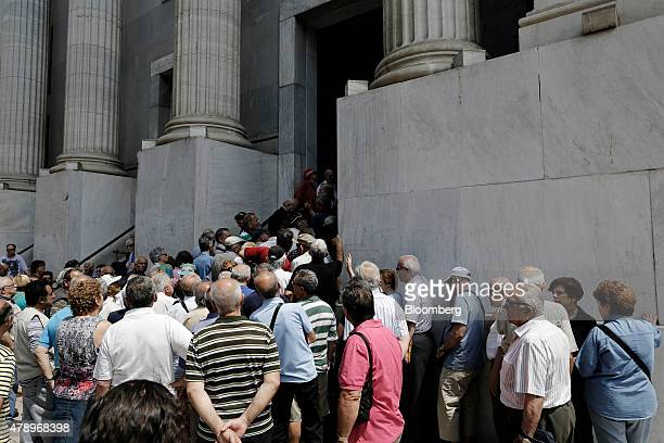 A large group of pensioners queue outside a closed main branch of the National Bank of Greece SA in the hope that it might open in Thessaloniki...