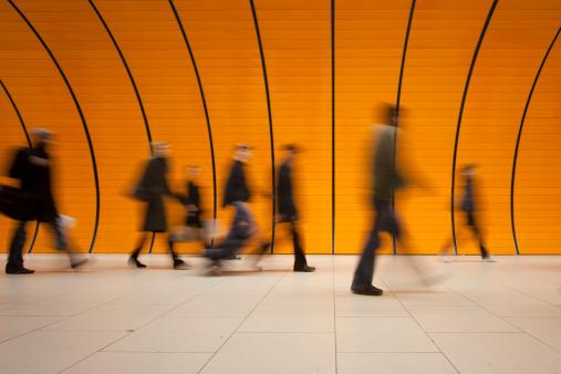 large group of people against modern orange subway tube - gettyimageskorea
