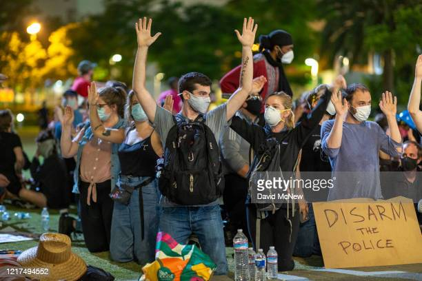 A large group of people are arrested for demonstrating past curfew near City Hall over the death of George Floyd on June 3 2020 in Los Angeles...