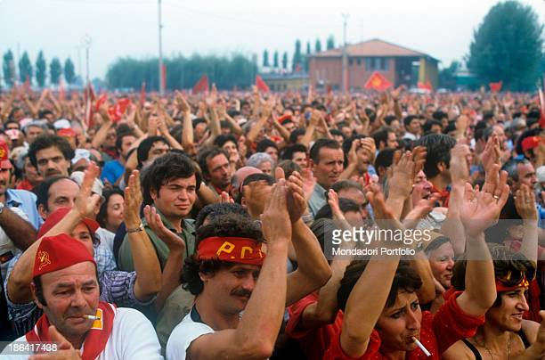 A large group of people clapping hands during the Festa de l'Unità Bologna September 1980