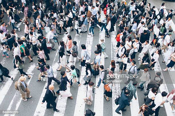 Large group of people crossing the street in Kyoto,Japan