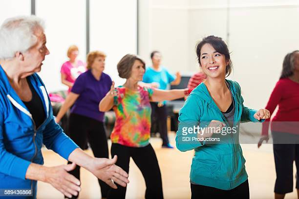 Large group of people enjoying dance lessons