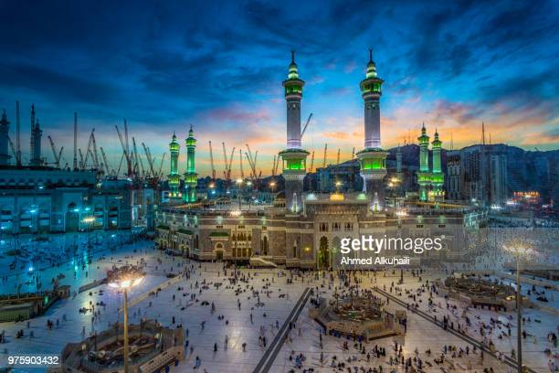 large group of people gathering outside al-masjid al-haram, mecca, saudi arabia - al haram mosque stock photos and pictures