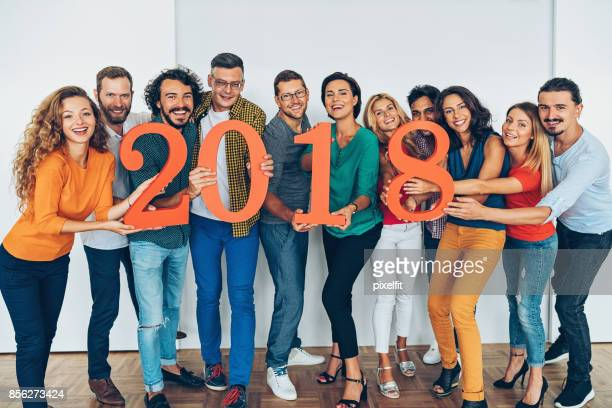 Large group of people holding 2018 numbers