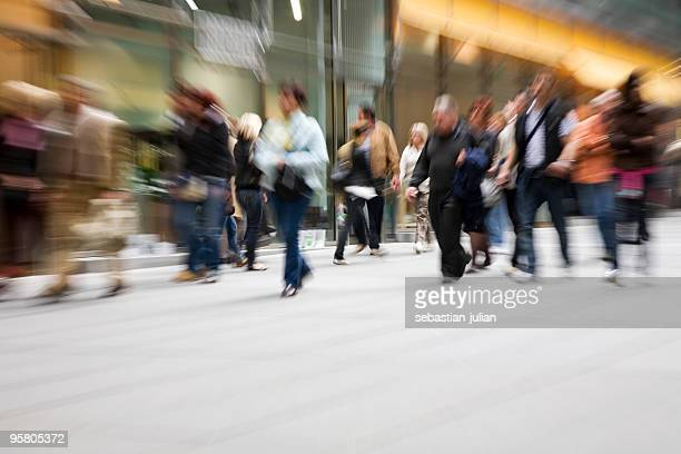 large group of people hurry up at shopping mall