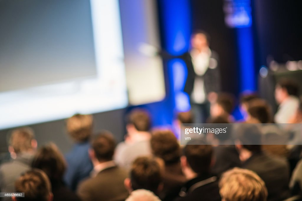 Large Group of People Listening to a Presentation : Stock Photo