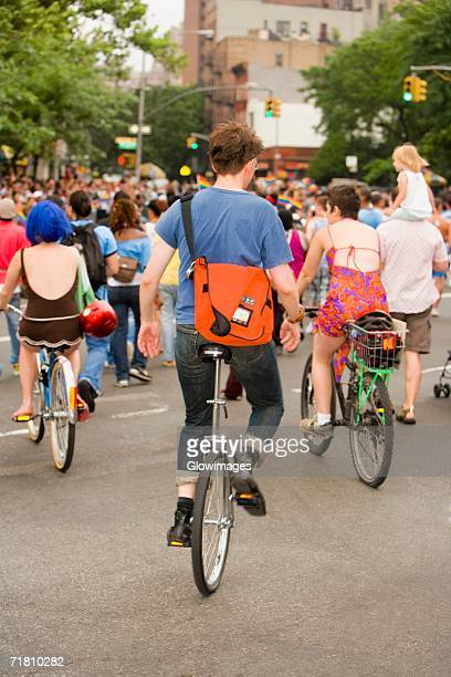 Large group of people on bicycles at a gay parade
