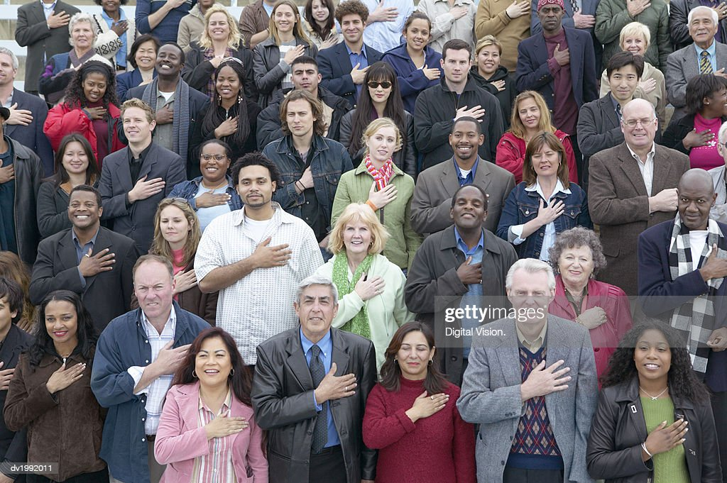 Large Group of People Pledging an Oath of Allegiance : Stock Photo
