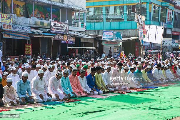 large group of people praying namaz on eil-al-adha - namaz stock pictures, royalty-free photos & images
