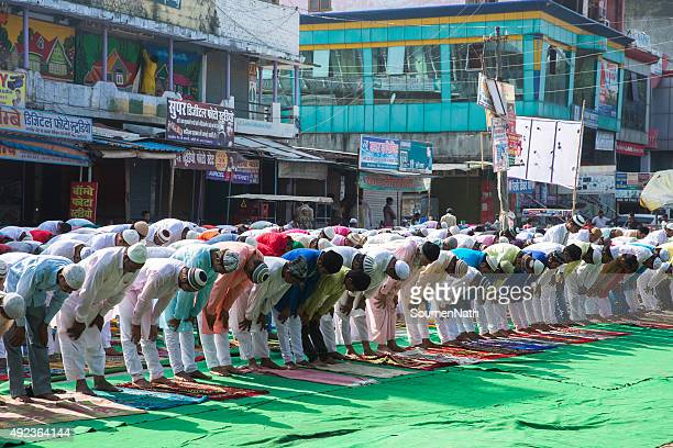 large group of people praying namaz on eil-al-adha - eid al adha stock pictures, royalty-free photos & images