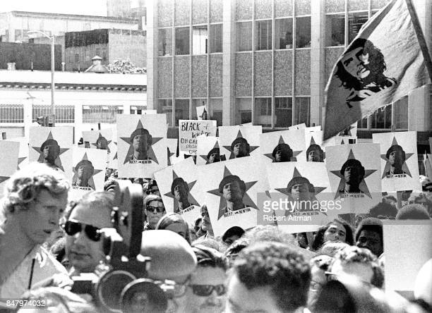 A large group of people show their support for the Black Panther Party while holding signs with the picture of Minister of Defense Huey P Newton on...