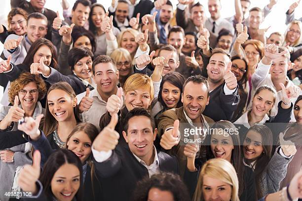 Large group of people smiling and giving thumbs up