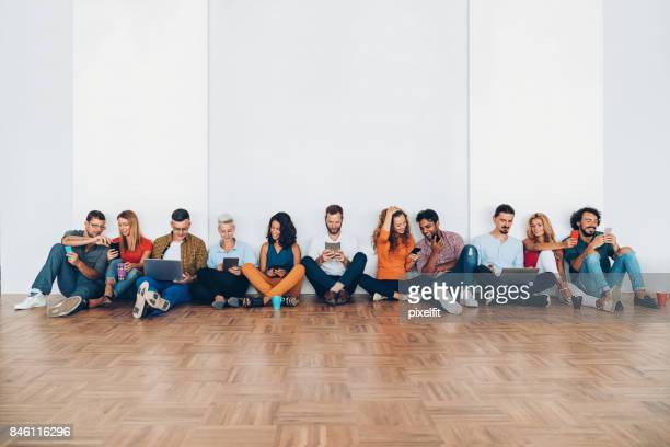 Large group of people social networking